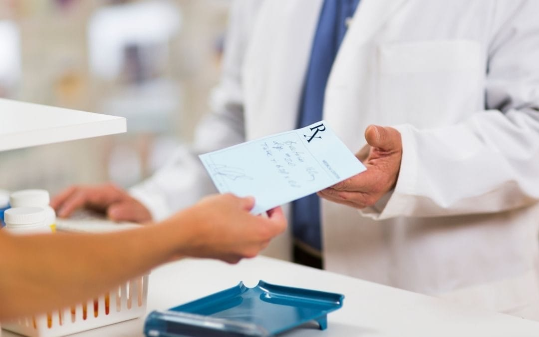 Patient handing pharmacist prescription